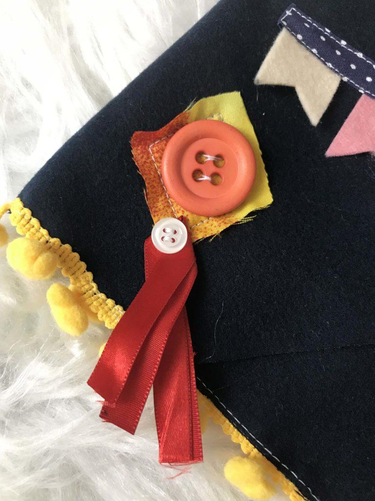 botão decorativo para customizar o colete de festa junina.